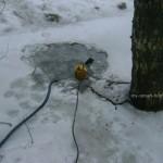 Откачка воды из канавы зимой